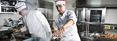 Chefs cooking in kitchen