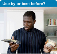 Use by or best before? Man looking at food products in his hands